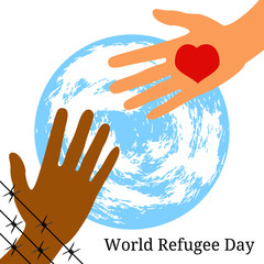 World Refugee Day. The hand behind the barbed wire stretches to the hand with the heart. Symbolic planet Earth