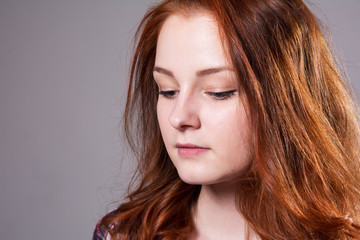Close-up portrait of a young woman looking down