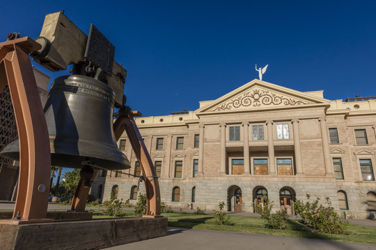 AUGUST 23, 2017 - PHOENIX ARIZONA - Replica of Liberty Bell in front of Arizona State Capitol Building at sunrise