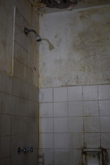 terrible and dirty broken shower in a cheap hotel