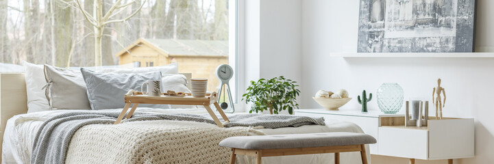 Bright bedroom with large window Fototapete