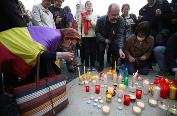 Members of the Committee for the Defence of the Republic (CDR) light candles in memory of jailed Catalonian politicians at Catalunya square in Barcelona