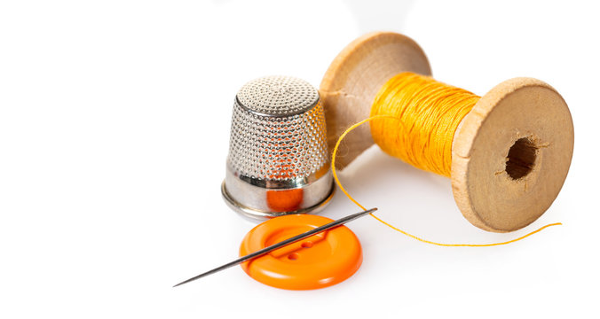 spool of thread and buttons
