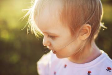 portrait of a happy little girl in the field