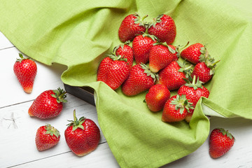 Top view of wooden box with strawberry, bright fresh fruit, copy space for text.