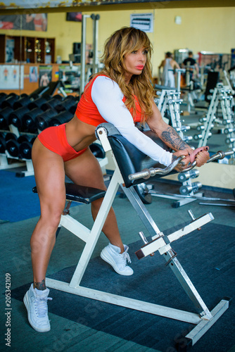 Bodybuilder Mature Sexy Woman Working Out In A Gym Fitness Woman Trained Female Body Lifestyle Portrait American Middle Age Model
