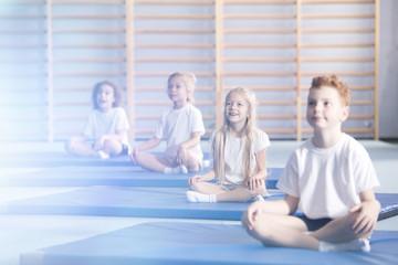 Amazed children in yoga classes
