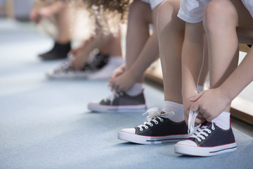 Kids tying sport shoes close-up