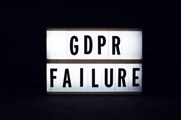 General Data Protection Regulation. Text GDPR failure on a display lightbox in the dark.