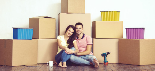 Young loving couple moving to a new house. Home and family concept.