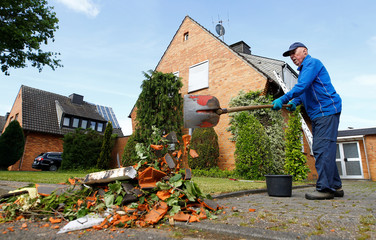 A man removes debris after a tornado last night hit the area of Boisheim