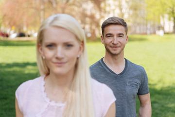 Young couple standing outdoors in an urban park