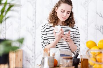 Woman testing vegan face cream