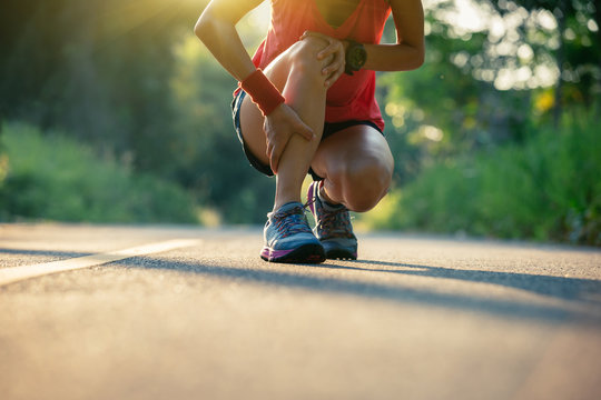 Woman runner got sports injury running on forest trail