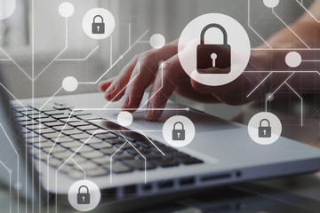 Cyber internet security concept. GDPR and cybersecurity. Protection of private personal data. A person using internet on laptop on the background.