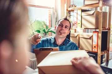 Men receiving package from courier