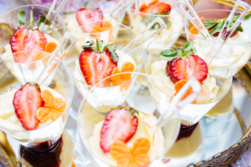 Wedding candy bar, tasty cakes with strawberry