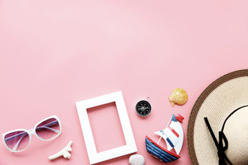 Beach hat,coconut leaves and glasses on pink background In the summer Asia,copy space,Top view,minimal style