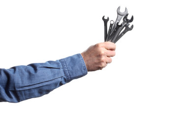 man's hand holding a group of wrenches on white background with clipping path and copy space