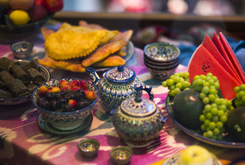 Home tableware in Russian traditional Gzhel style. Closeup. Gzhel - Russian folk craft of ceramics and production porcelain and a kind of Russian folk painting. Blurred focus