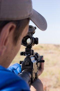 Man looking through aim