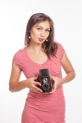 Portrait of a young woman taking a picture with a camera.