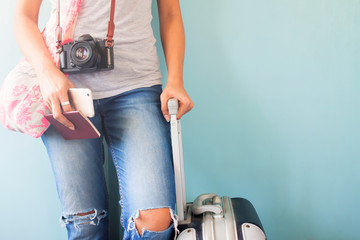 Travel tourist standing with suitcase holding passport and smart phone, Summer vacation concept