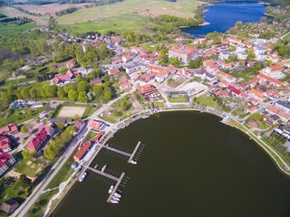 Aerial view of Ryn town, Poland (former Rhein, East Prussia). Medieval teutonic knights castle on the right