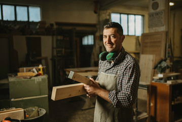 Image of mature carpenter in the workshop