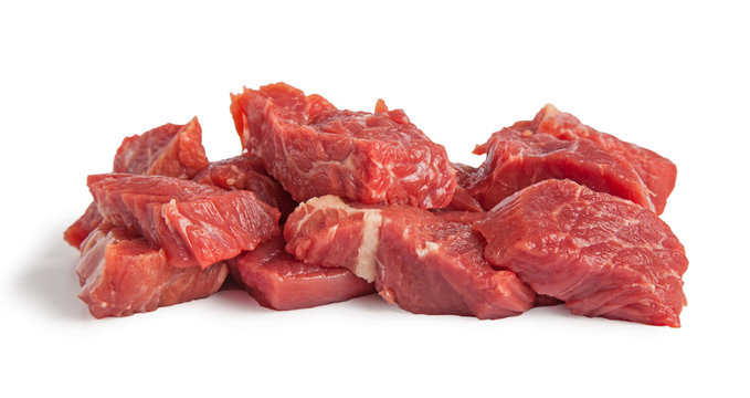 Raw beef pieces isolated on a white background