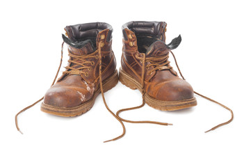 Wall Mural - Pair of dirty brown boots isolated on white background