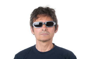Portrait of seriously man in sunglasses on white background