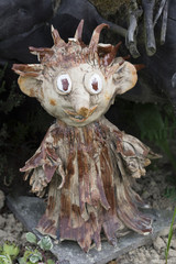 Small wooden elf in the garden as a decoration.