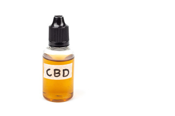 Medicinal cannabis with extract oil in a bottle isolated on white background.
