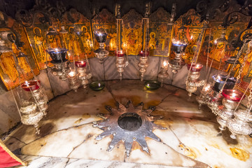 A silver star marks the traditional site of the birth of Jesus in a grotto underneath Bethlehem's Church of the Nativity, Palestine.