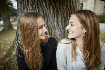 Two smiling young women outdoors