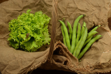 salad and broad bean in a wicker basket