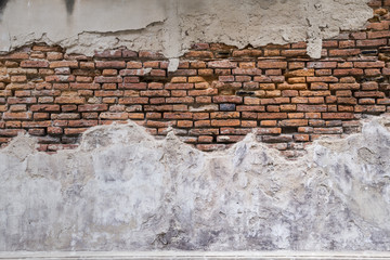 Empty Old Brick Wall Texture. walls disintegration see red brick. Building Facade With Damaged...