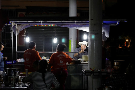 A man with a hat eats local food in Tequila