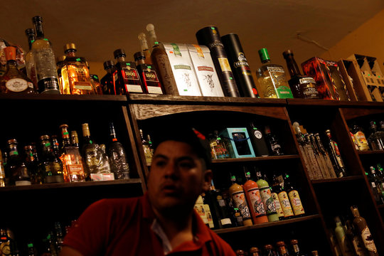 Bottles of tequila and other liquors are seen inside a shop in Tequila