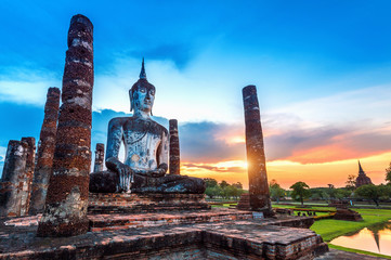 Wall Mural - Buddha statue and Wat Mahathat Temple in the precinct of Sukhothai Historical Park, Wat Mahathat Temple is UNESCO World Heritage Site, Thailand.