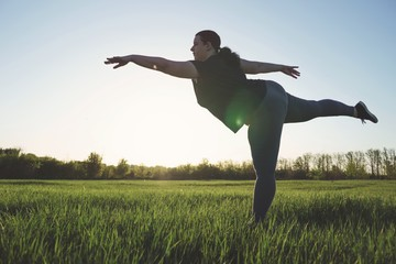 Body positive, confidence, high self esteem. Overweight woman dancing outdoors. Freedom concept