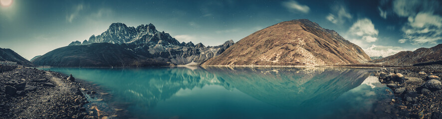 Wall Mural - Spectacular scenery the crystal clear Gokyo Lake on the mighty snow-covered Himalayas background. Strength and beauty of wild virgin nature. Ideal image for the backgrounds and wallpapers.