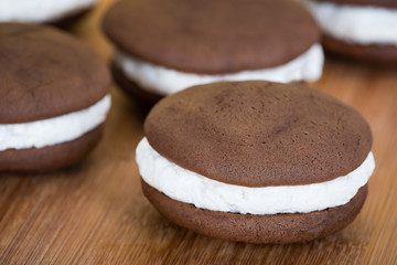 Canvas Prints Dessert Whoopie pies or moon pies, chocolate cake desserts filled with creamy frosting against wooden background