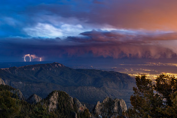 Lightning from a distant thunderstorm over the city of Alburquerque, New Mexico