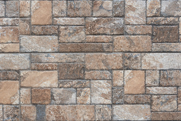 Seamless texture of brown stone - Stone tile floor paving fragment.