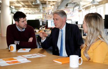 Britain's Chancellor of the Exchequer Philip Hammond talks to staff during a visit to Nucleus Finance in Edinburgh