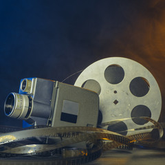 8 mm vintage movie camera with a reel of film in smoke