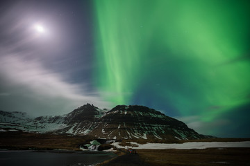 Aurora Borealis exploded on the mountain like the volcano eruption / Kirkjufell one of the most famous landmark in Iceland / Landscape photography