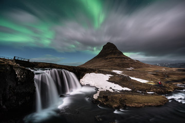 Aurora Borealis exploded on the mountain at Kirkjufell one of the most famous landmark in Iceland / Landscape photography